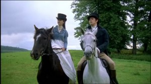 Horseback riding in big hats.